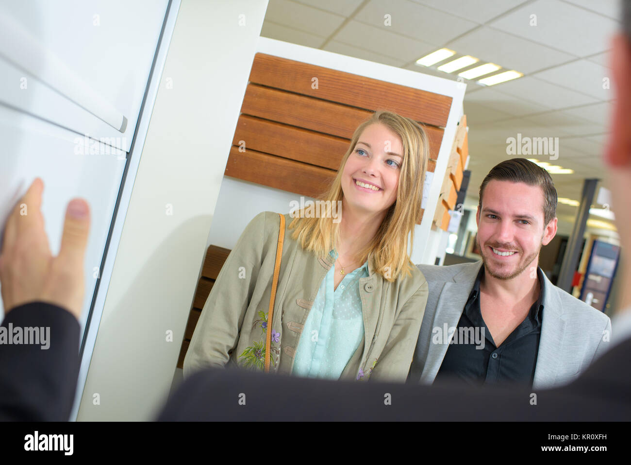 smiling customers - Stock Image