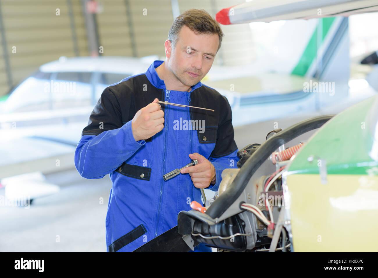 fixing an aiplane - Stock Image