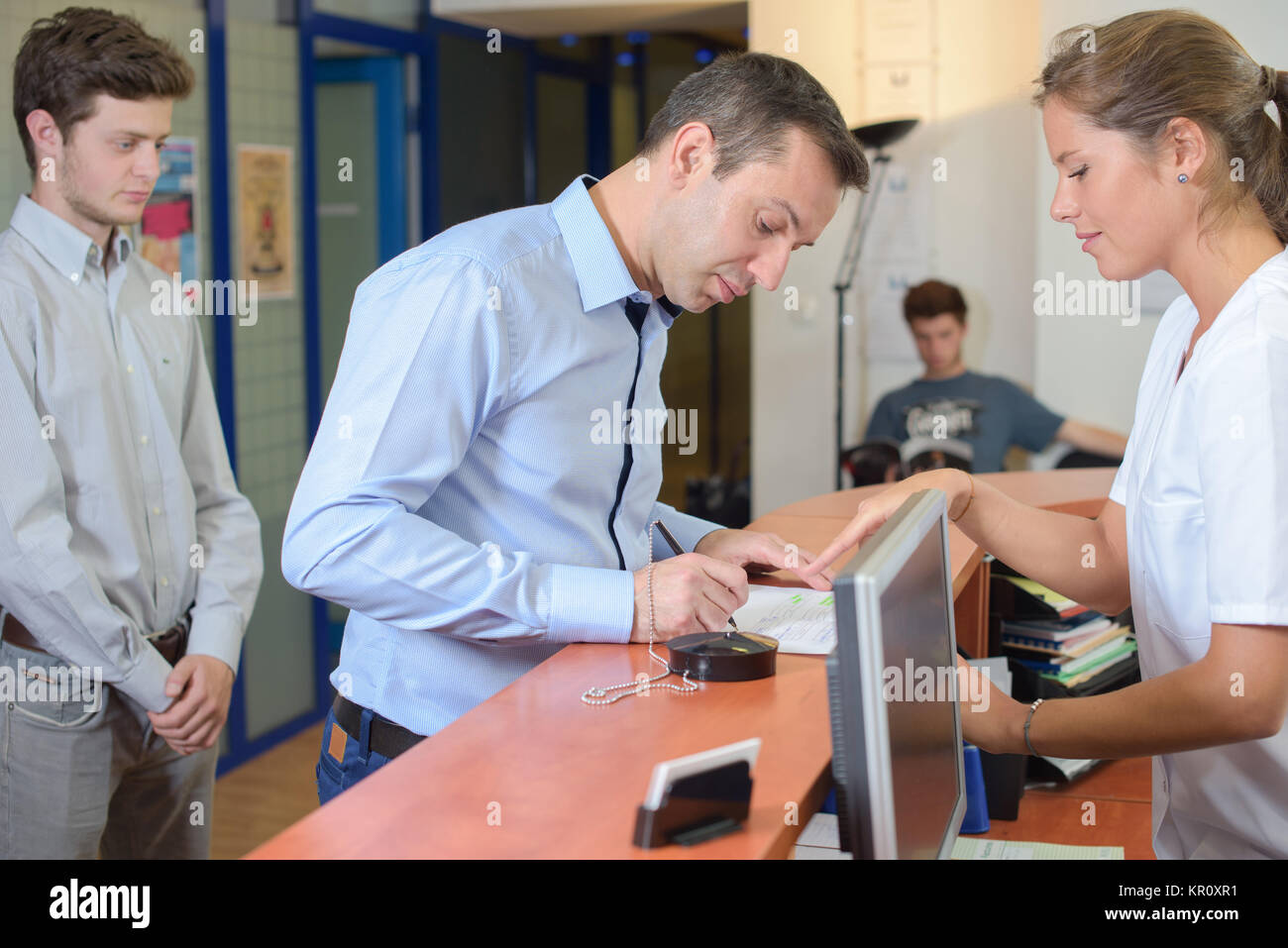 filling up forms - Stock Image
