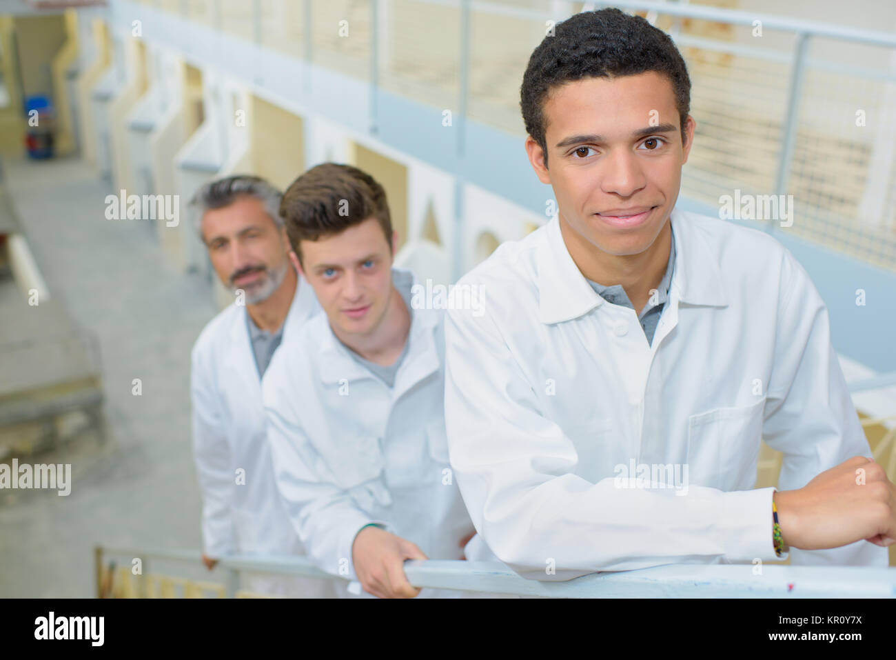 three men in the stairs - Stock Image