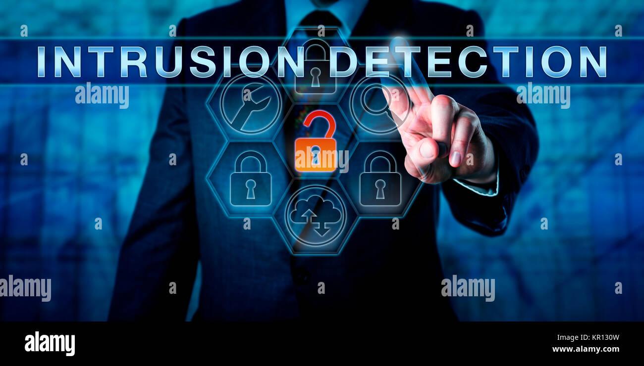 Businessman Pushing INTRUSION DETECTION - Stock Image