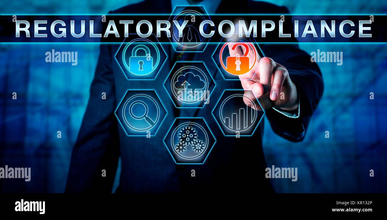 Governance Officer Pushing REGULATORY COMPLIANCE - Stock Image