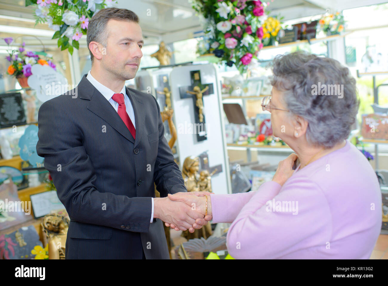 greeting a customer - Stock Image