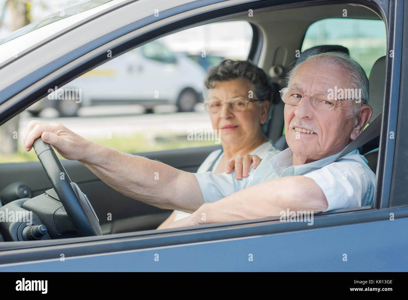 elderly couple in the car - Stock Image