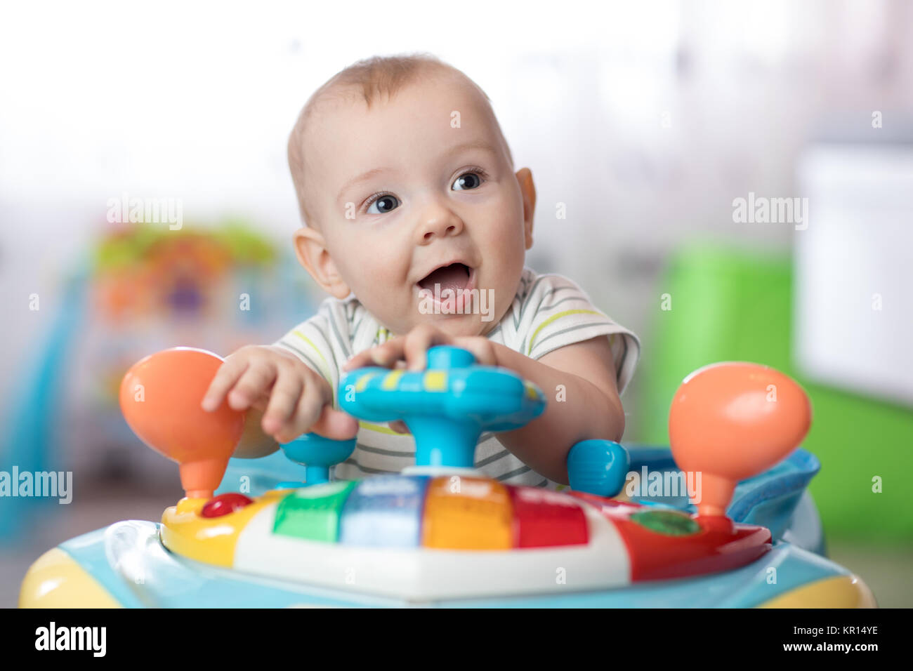 8120248e9 funny baby playing in baby jumper Stock Photo  169056258 - Alamy