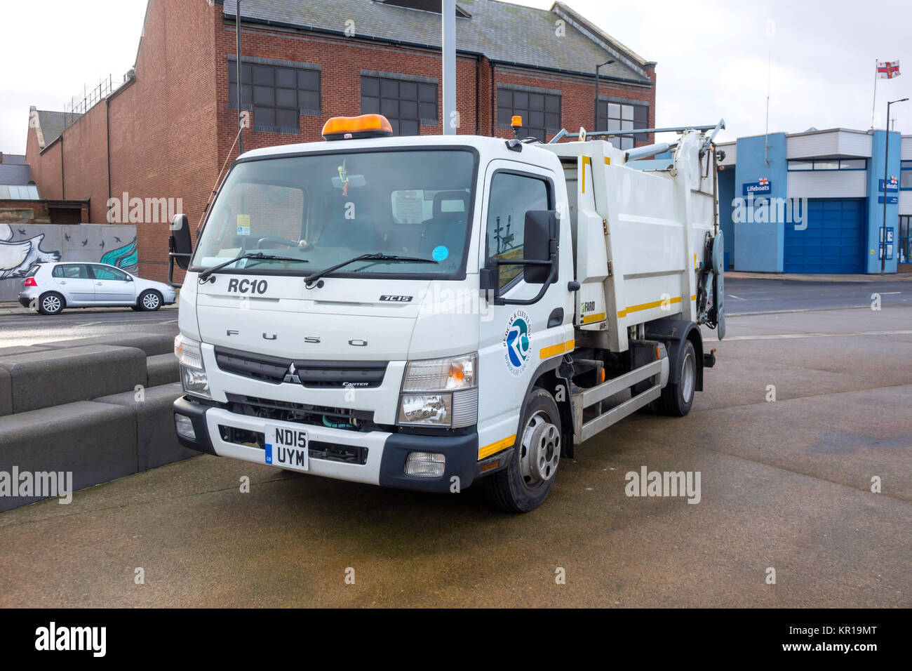 Fuso 7C15 truck fitted with a waste collection and tipping body used by Local Authorities for collecting rubbish - Stock Image