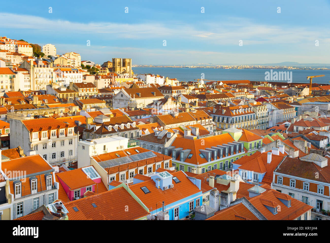 Skyline of Lisbon with famous Lisbon Cathedral at sunset. Portugal - Stock Image
