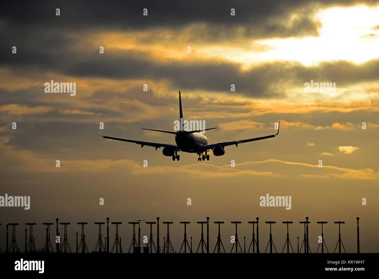 Ryanair Boeing 737 airliner jet plane landing at London Stansted Airport at sunset. Dusk. Evening. Space for copy - Stock Image