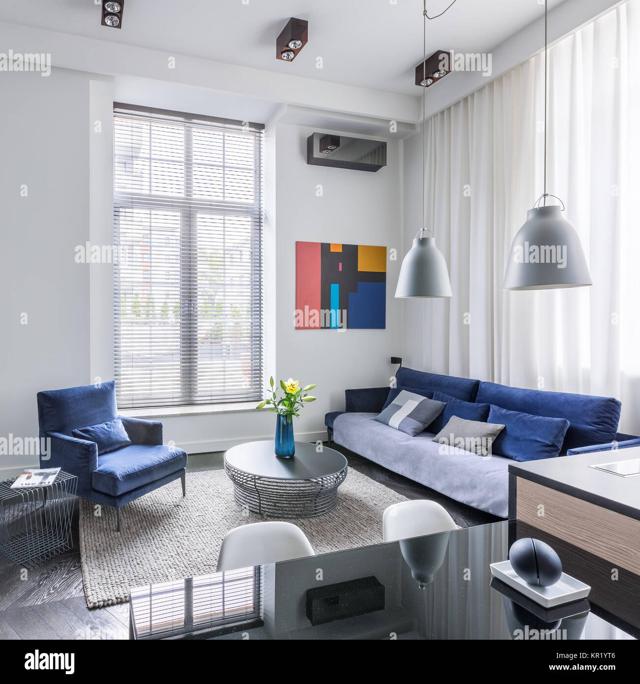 Industrial design living room with tv and blue furniture set Stock ...