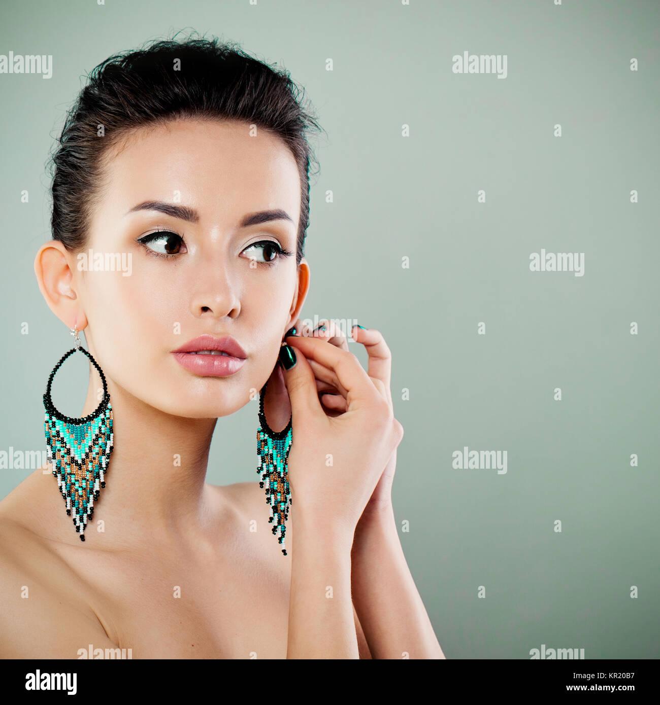 Beautiful Woman with Perfect Makeup Wearing Fashion Earrings Stock Photo