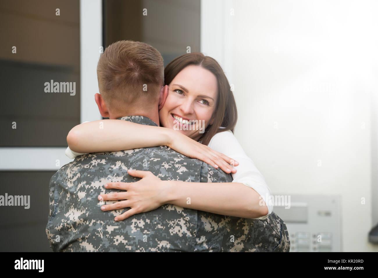 Happy Wife Hugging Her Husband - Stock Image