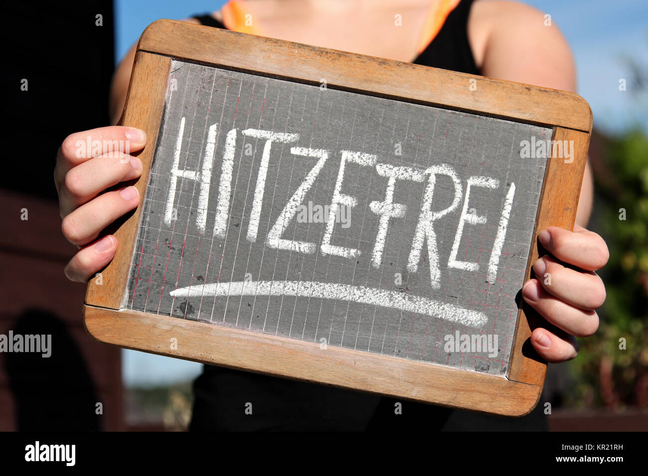 HITZEFREI (German for:  to have time off from school on account of excessively hot weather) written with chalk on - Stock Image