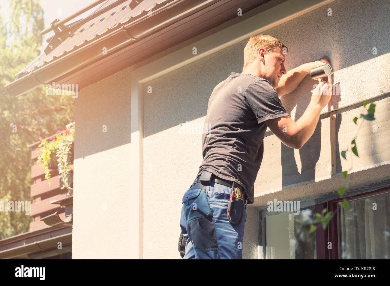 Fix It Services Stock Photos Images Alamy 0800 Handyman Changing A Light Fitting Wiring Electrician Installing Lamp On House Facade Image
