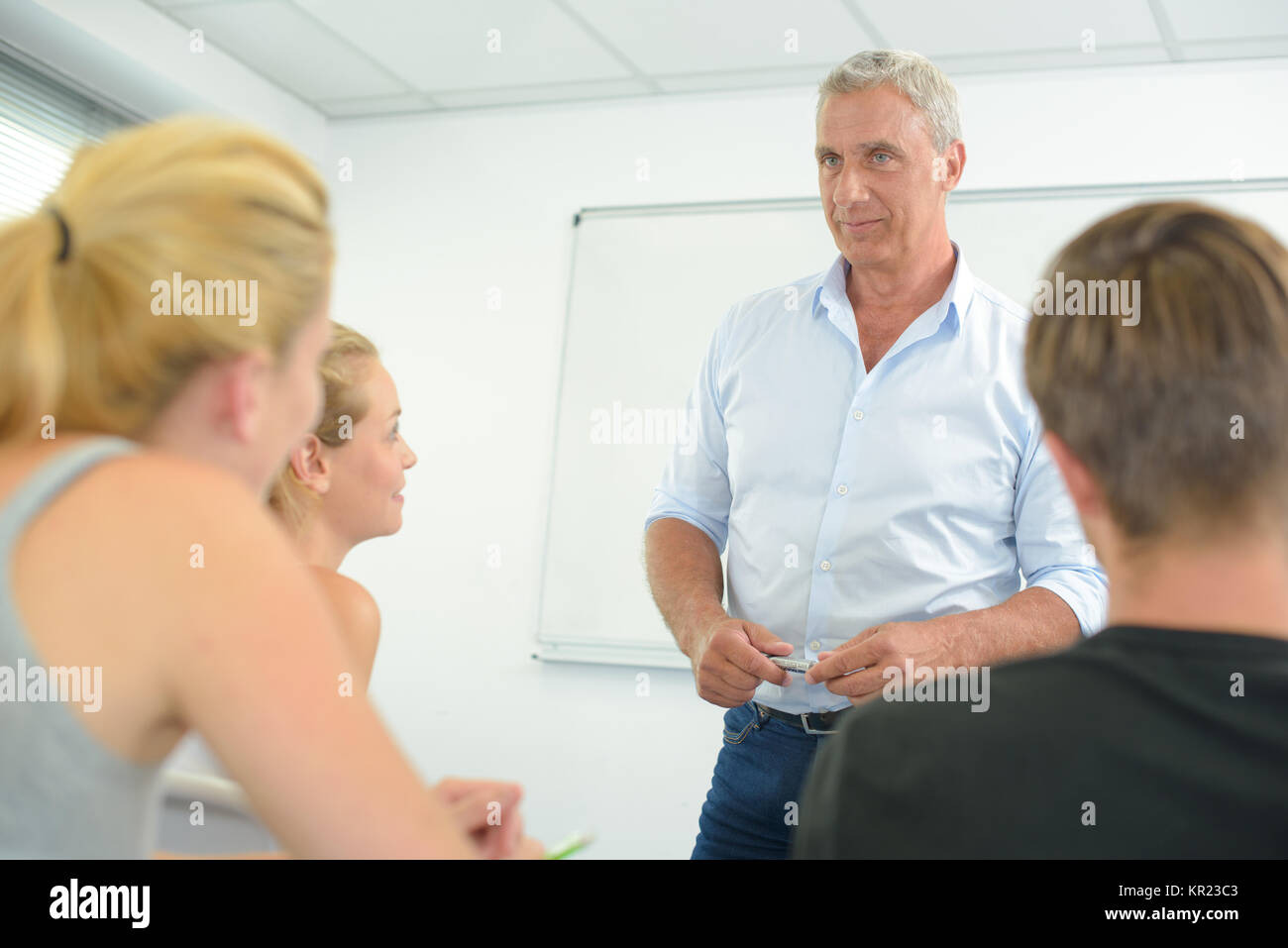 teacher giving a lecture - Stock Image