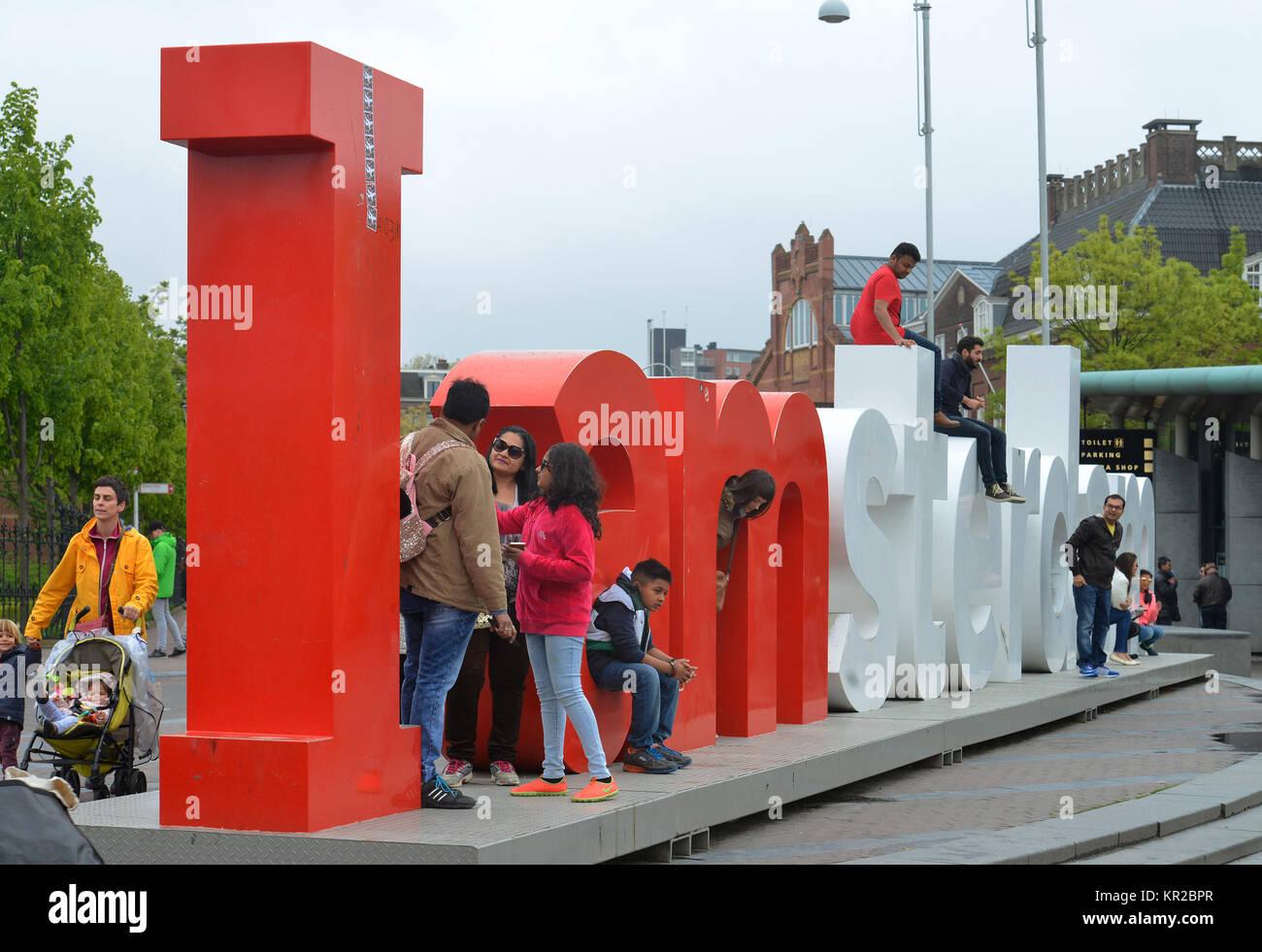Tourists, Museumplein, Amsterdam, the Netherlands, Touristen, Niederlande - Stock Image