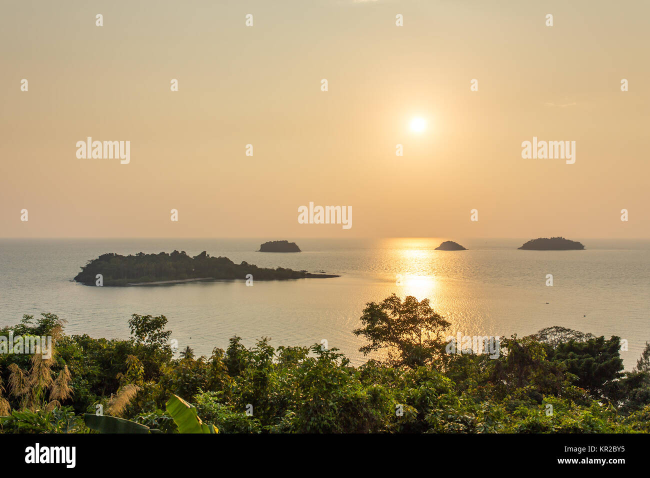 Beautiful tropical island landscape. View from Koh Chang to Koh Man Nai during sunset - Stock Image
