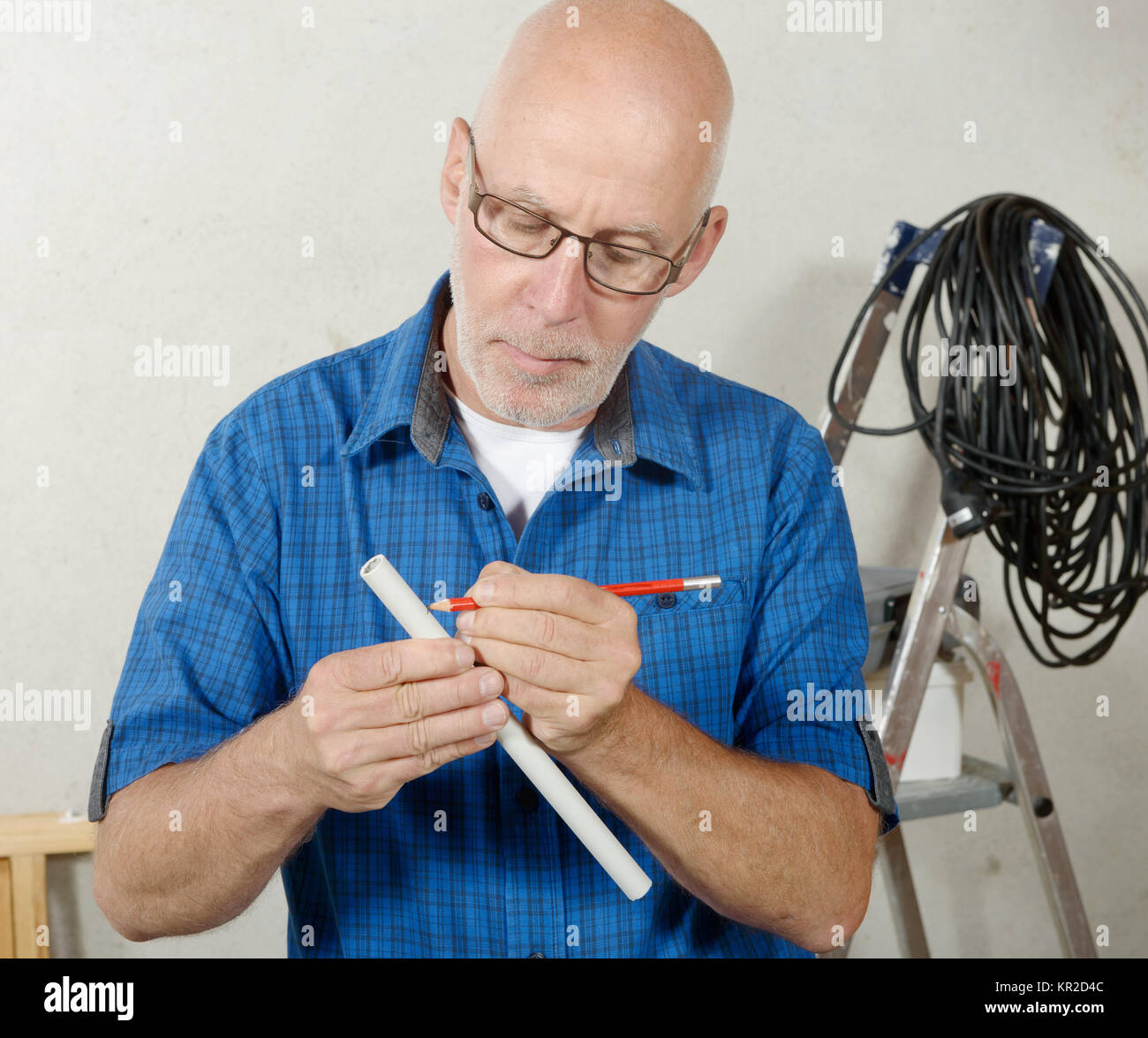 electrician man in his workshop - Stock Image