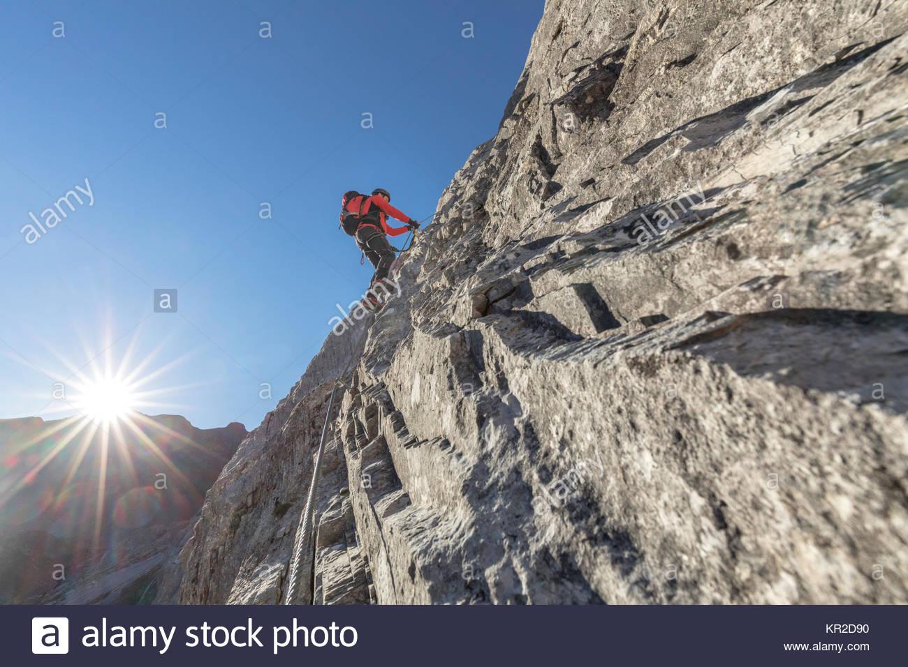 Mountaineer along the via ferrata on the north side of mount Gr. Kinigat, Kartitsch, East Tyrol, Austria, Europe - Stock Image