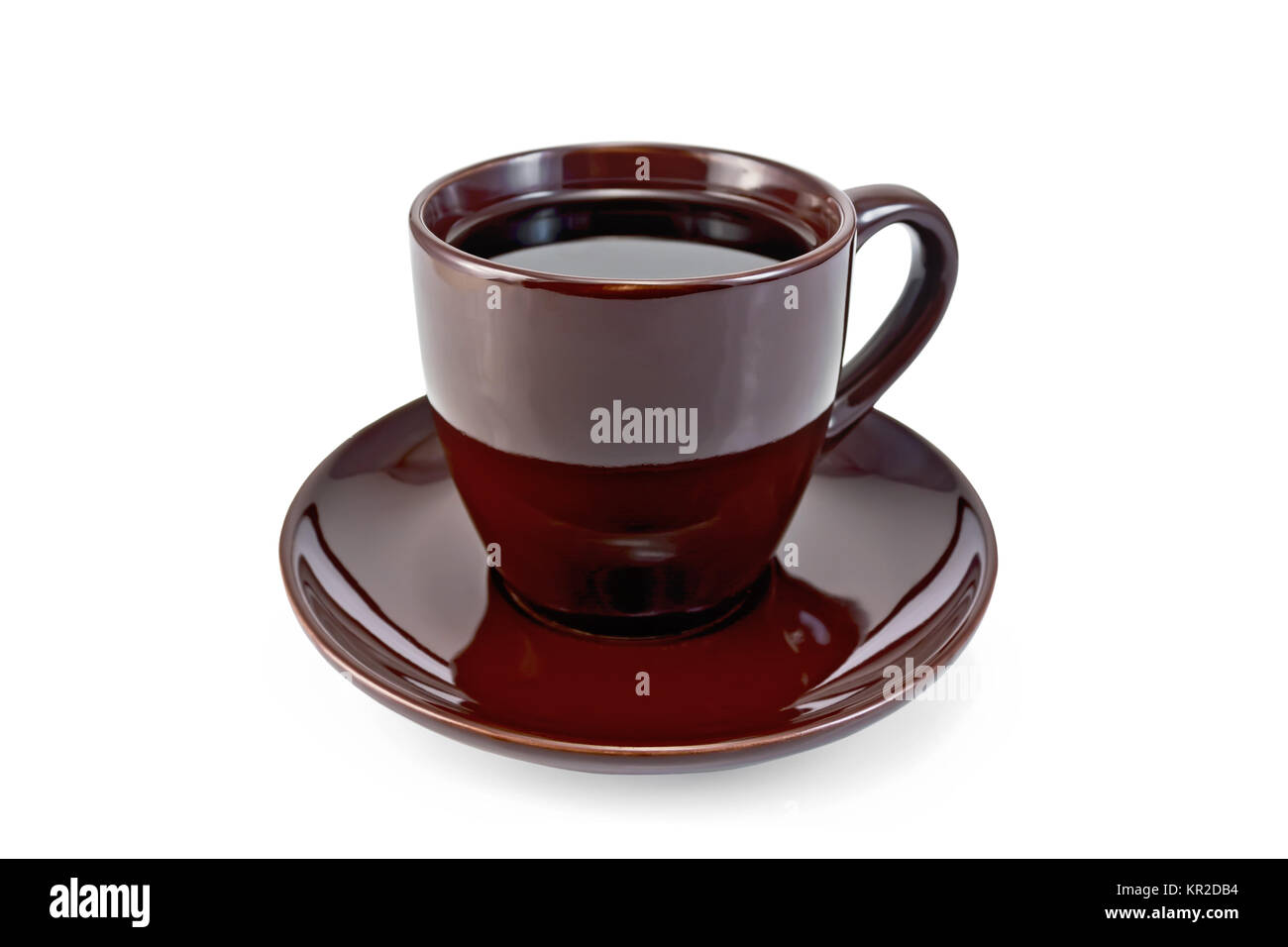 Coffee in brown cup on saucer Stock Photo