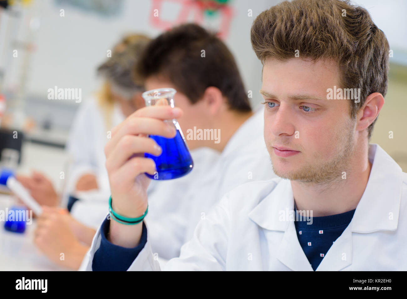 chemical inside a flask - Stock Image