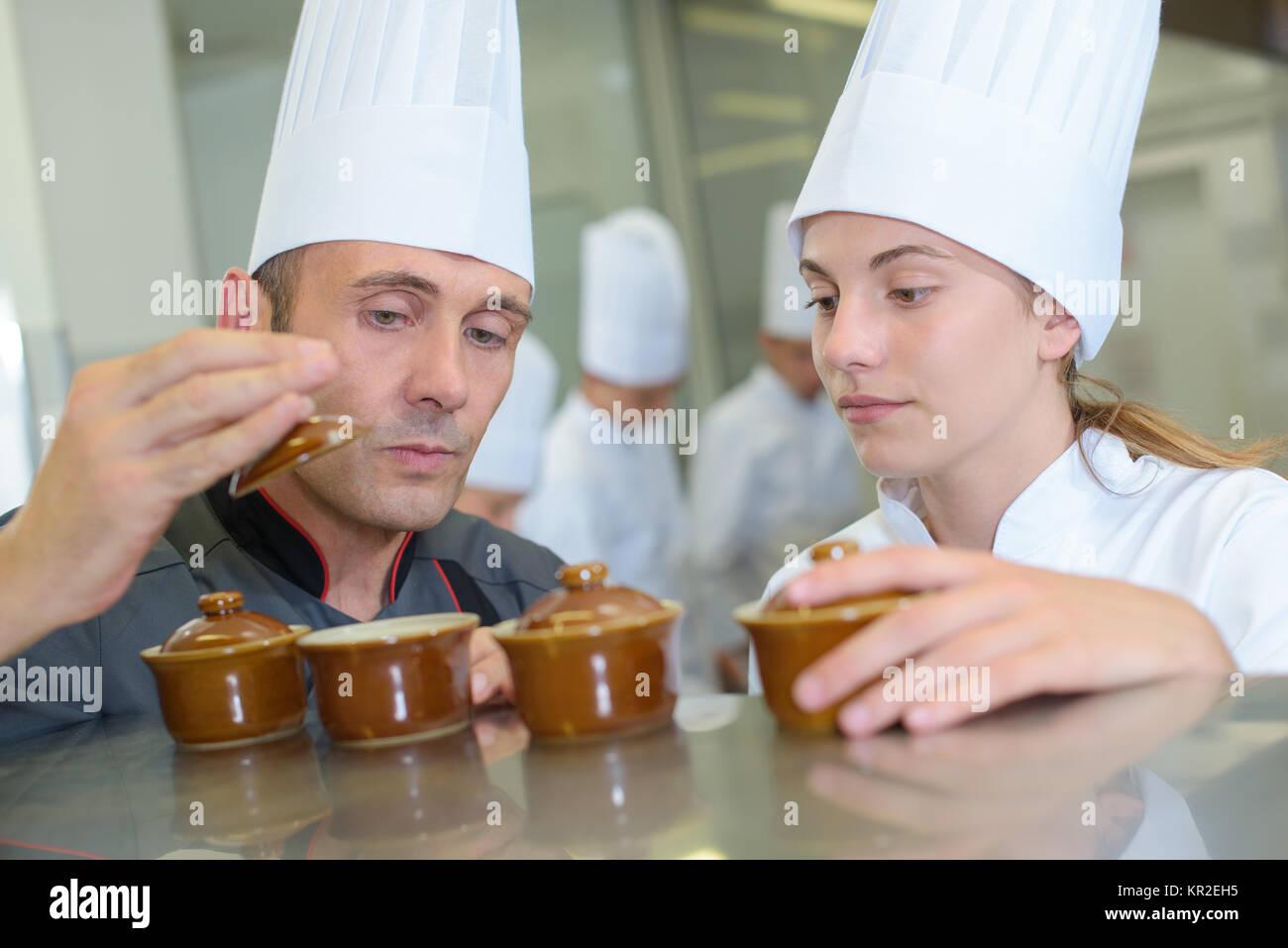 Chef holding lid of ramekin pot - Stock Image