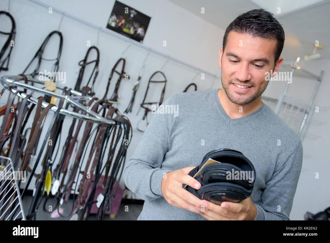man buying leather - Stock Image