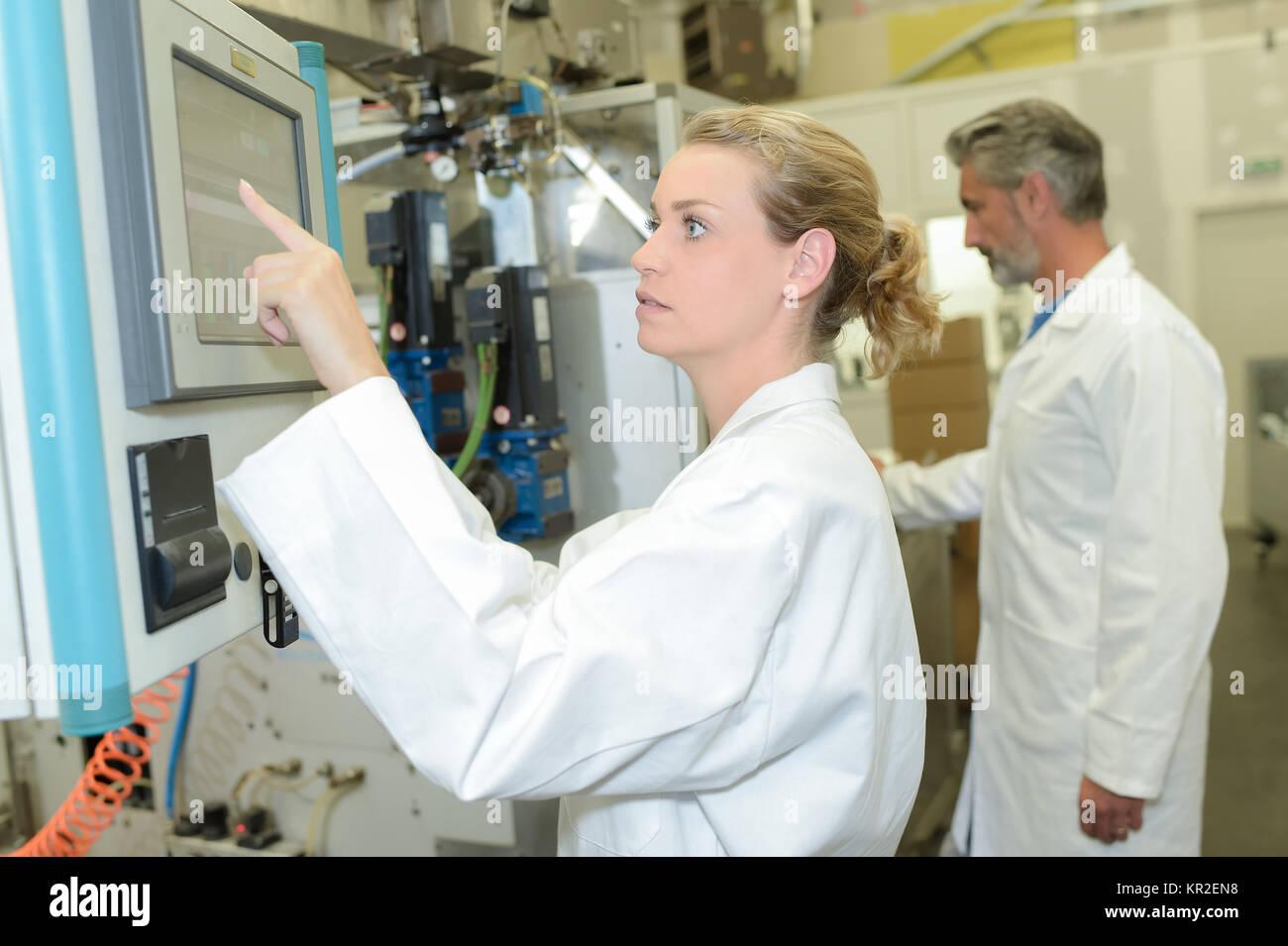 adjusting the machine - Stock Image