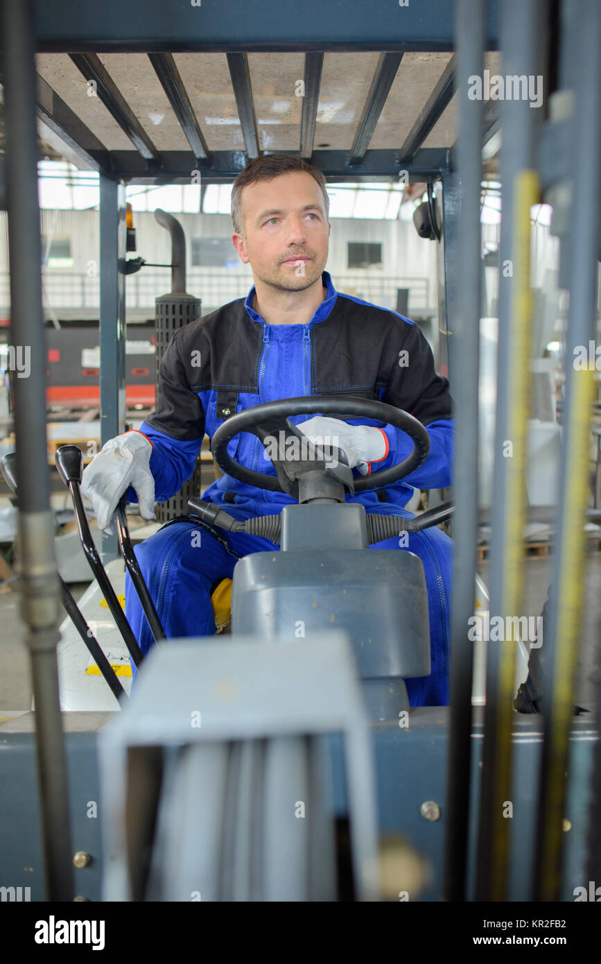 man driving a forklift - Stock Image