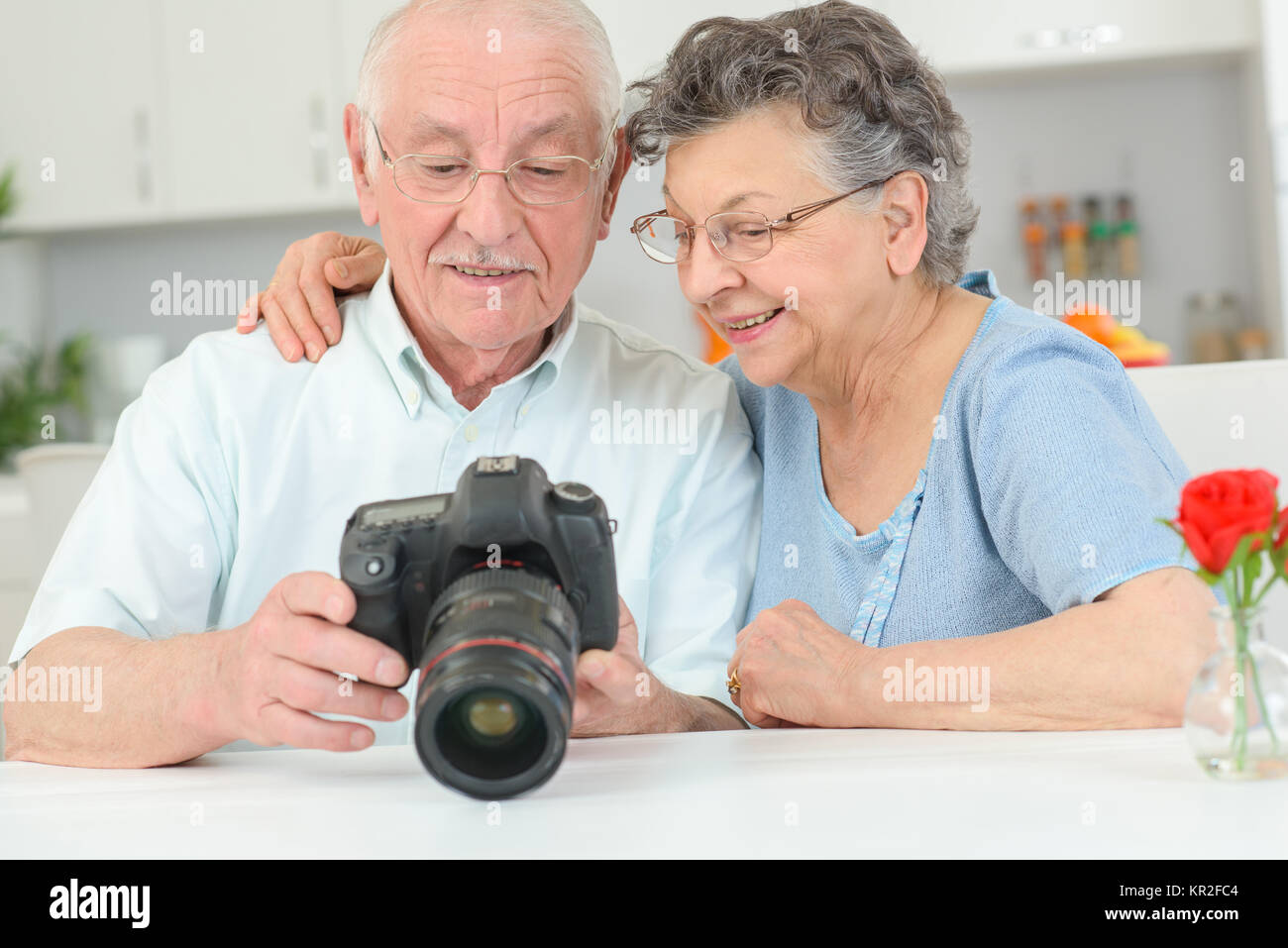 elderly couple with a high speed camera - Stock Image