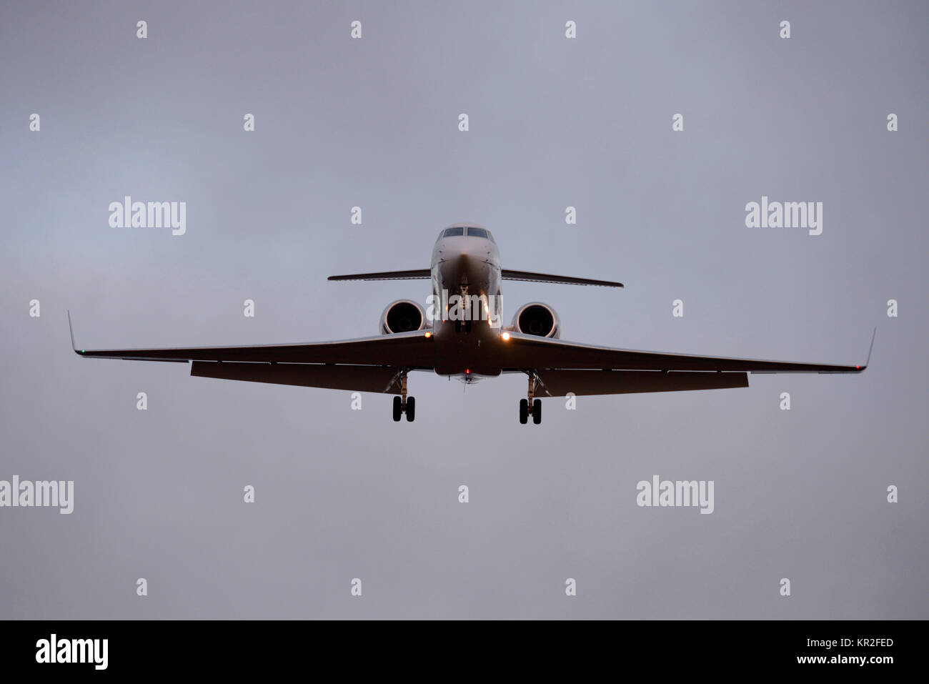 Gulfstream V GV jet plane landing at London Stansted Airport at dusk. Space for copy - Stock Image