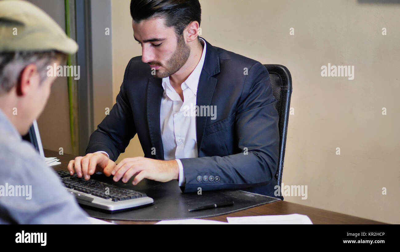 Businessmen working together on projects - Stock Image