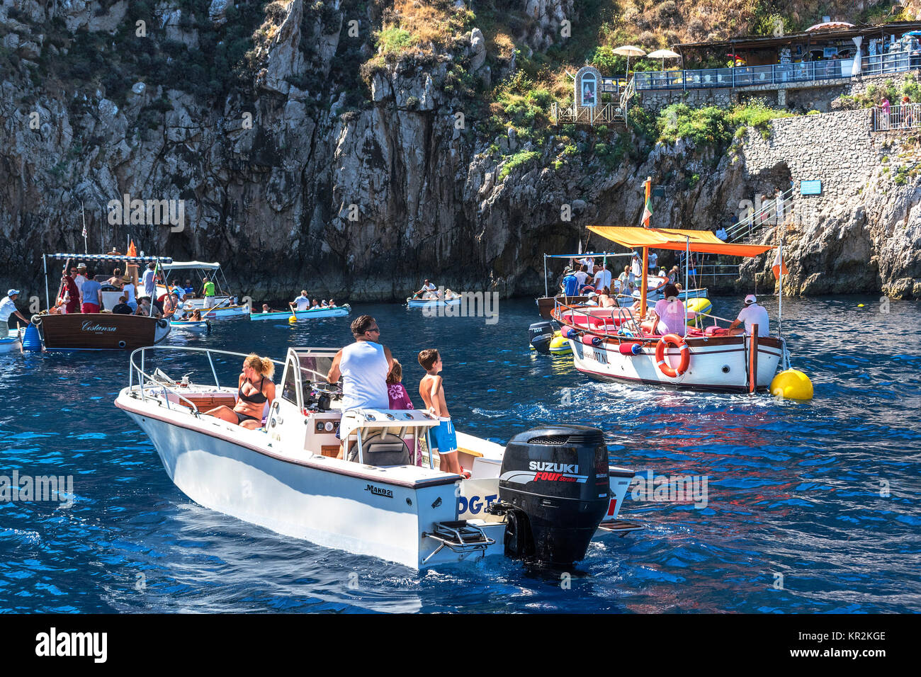 tourists waiting to enter the blue grotto on the island of capri, italy. - Stock Image