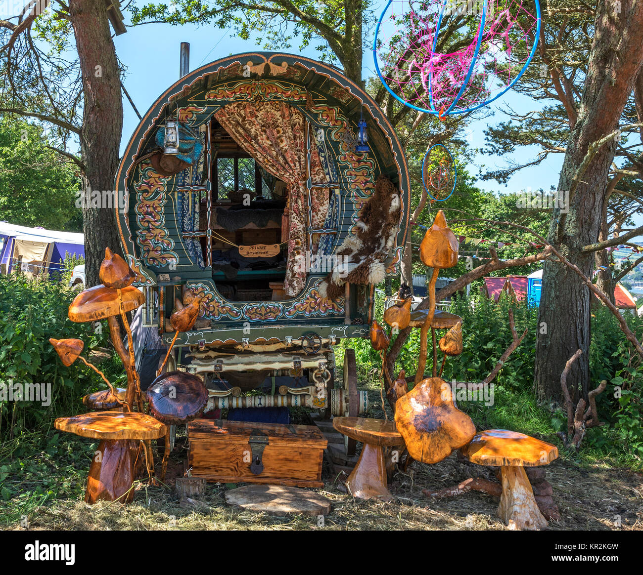 gypsy caravan with mushroom and toadstool wood carvings for sale. - Stock Image