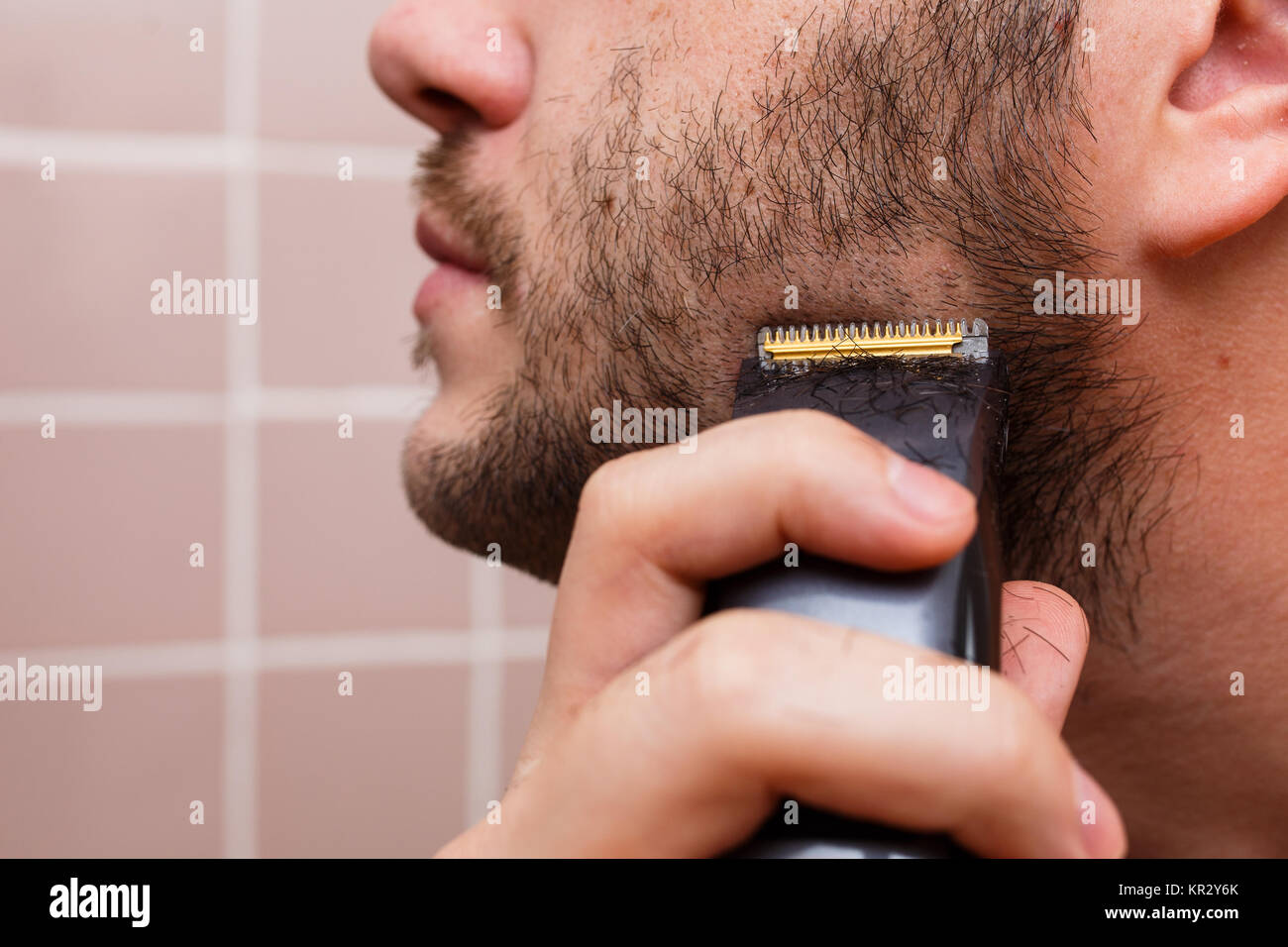 Man shaving with trimmer Stock Photo