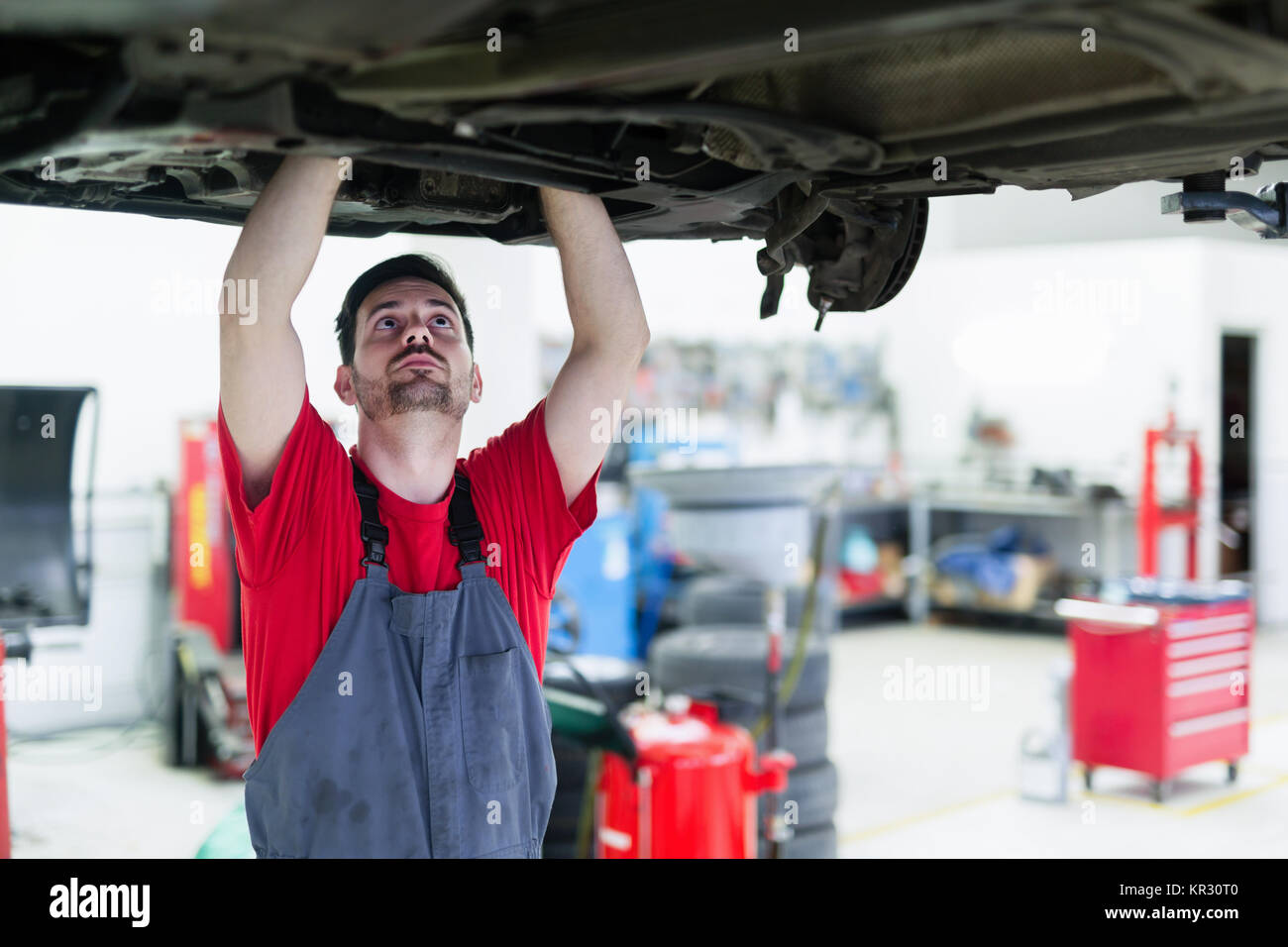 Car mechanic working at automotive service centera - Stock Image