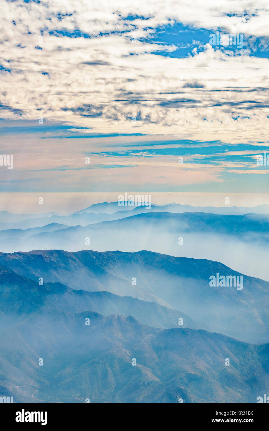 Window plane point of view aerial landscape scene from andes range mountains at chilean territory - Stock Image