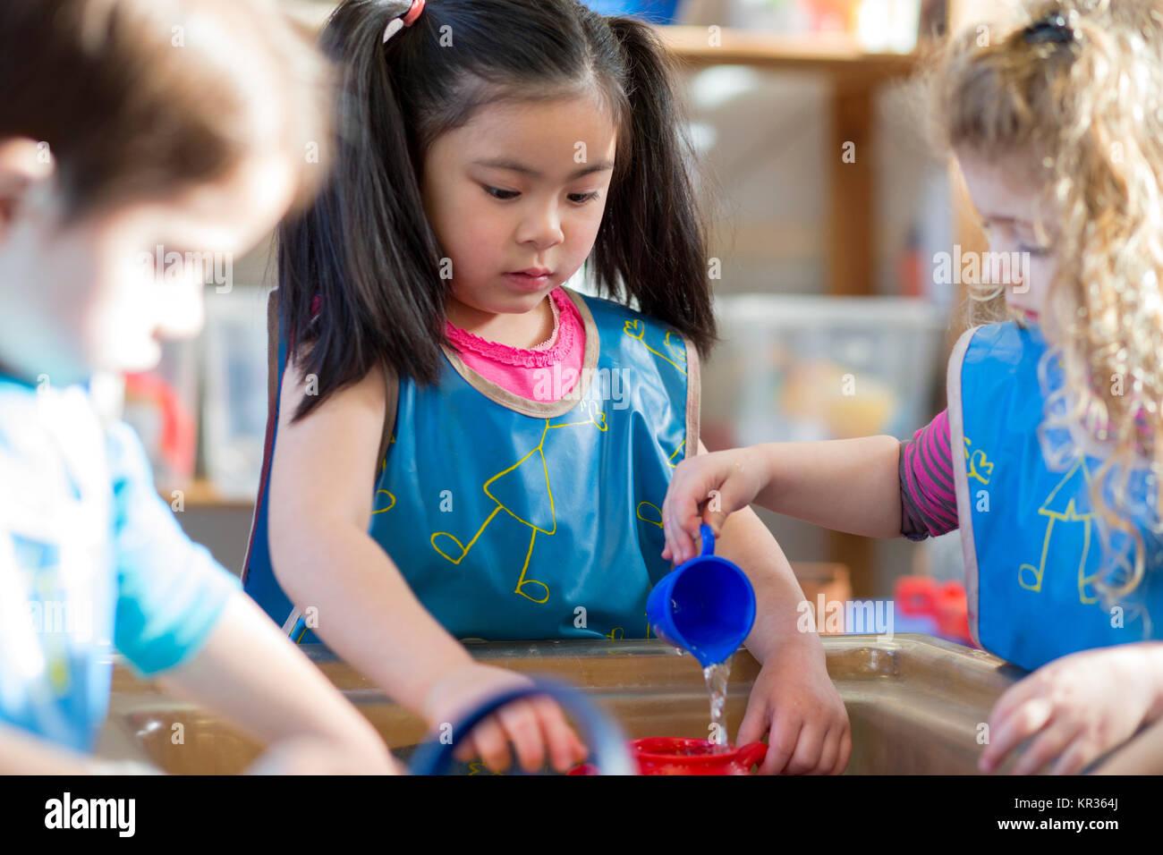 Aqua Play at Nursery - Stock Image