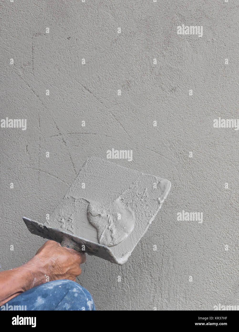 Builder worker plastering concrete Stock Photo