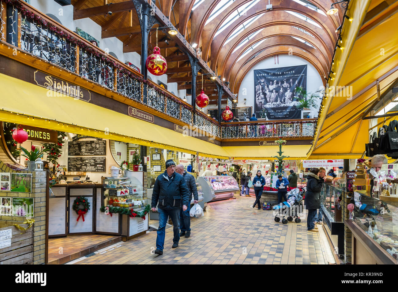 English Market, Cork, Ireland in the run up to Christmas with lots of Christmas shoppers and Christmas decorations. - Stock Image