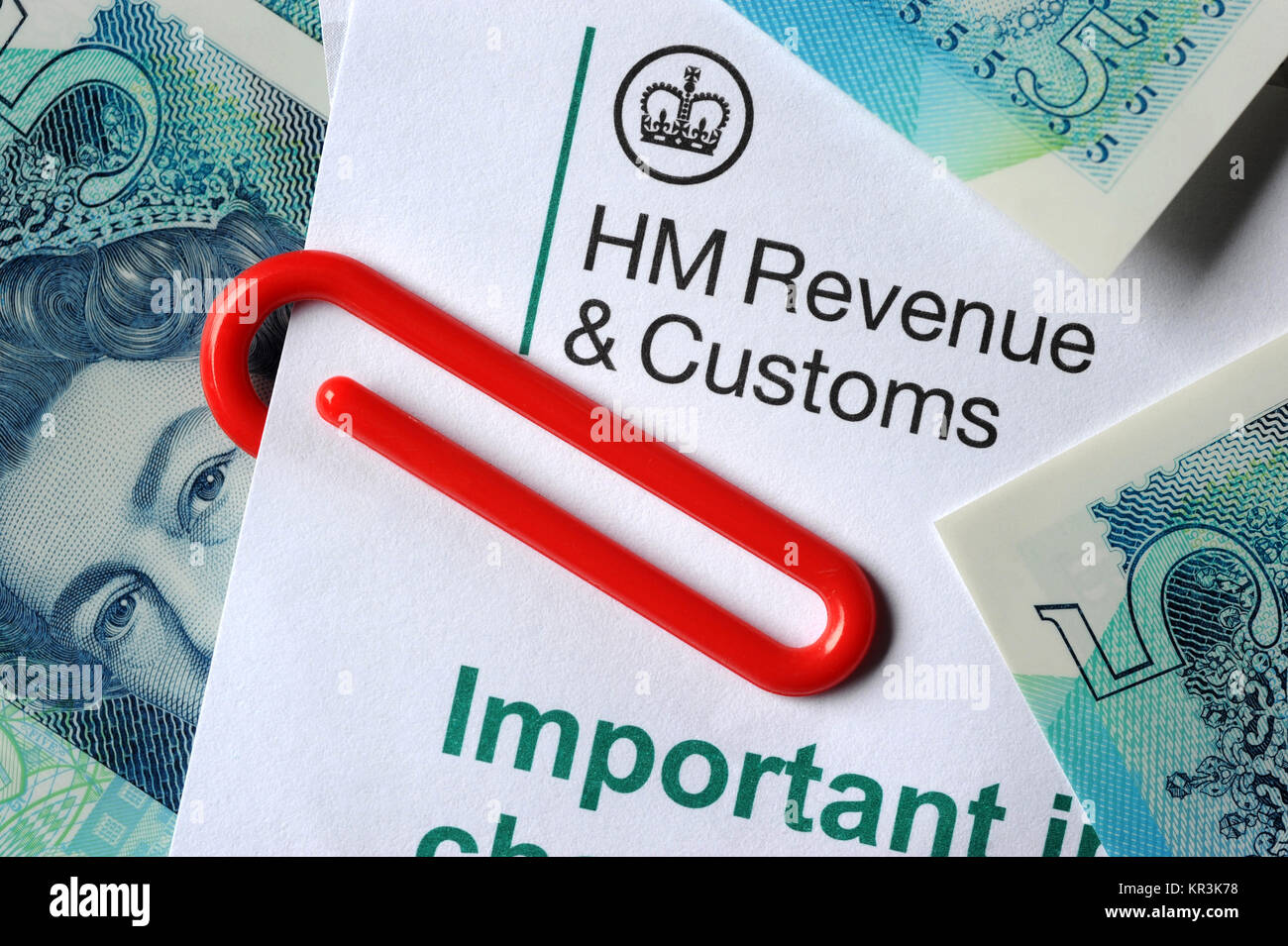 HMRC INLAND REVENUE LETTER WITH NEW FIVE POUND NOTES AND PAPER CLIP RE TAX H M REVENUE AND CUSTOMS TAXES INCOMES - Stock Image