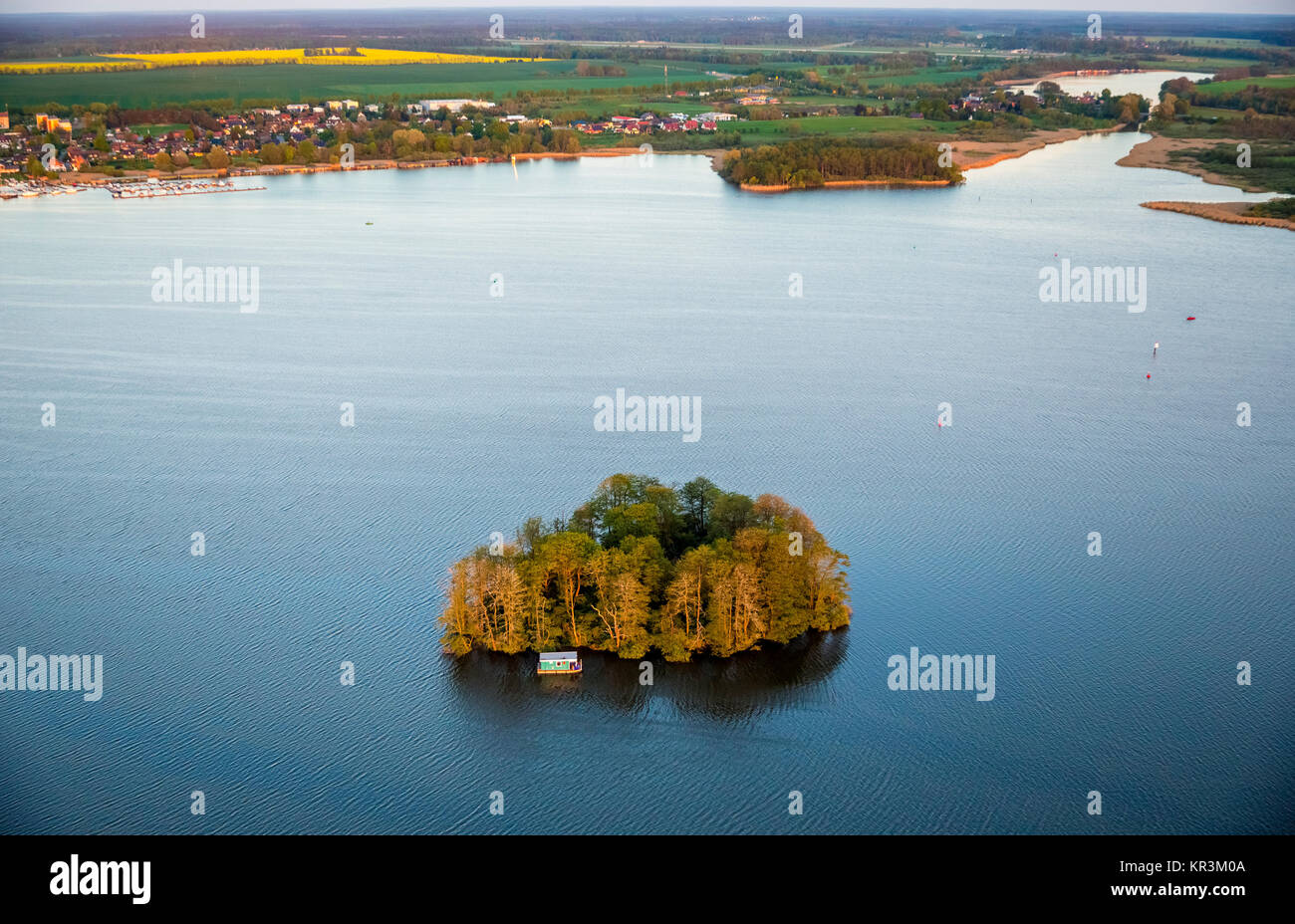 The Muritz with heart-shaped island and residential boat and pleasure boat in the sunset, Vipperow, Mecklenburg Stock Photo