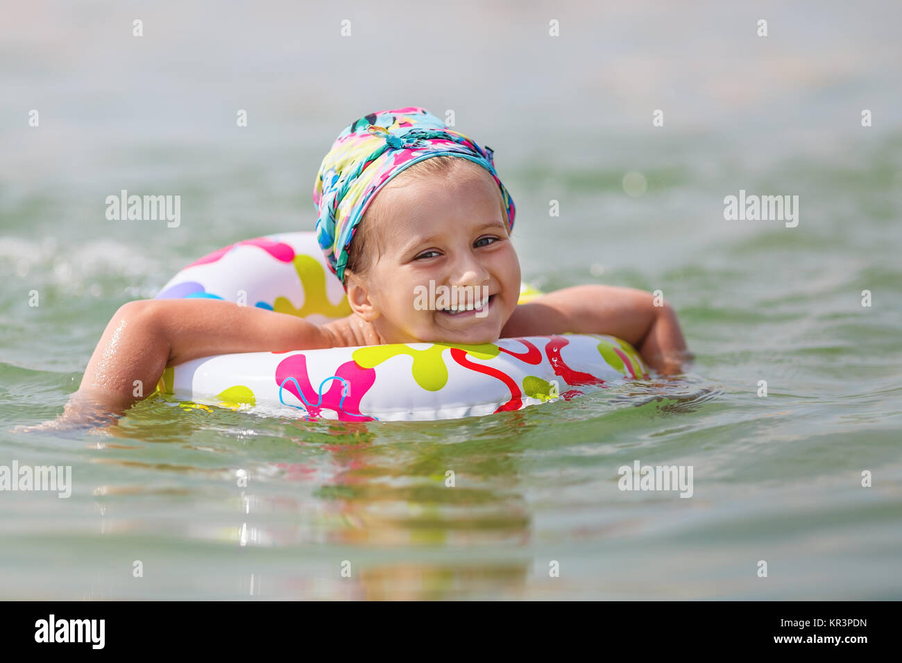 Baby bathing in the sea - Stock Image