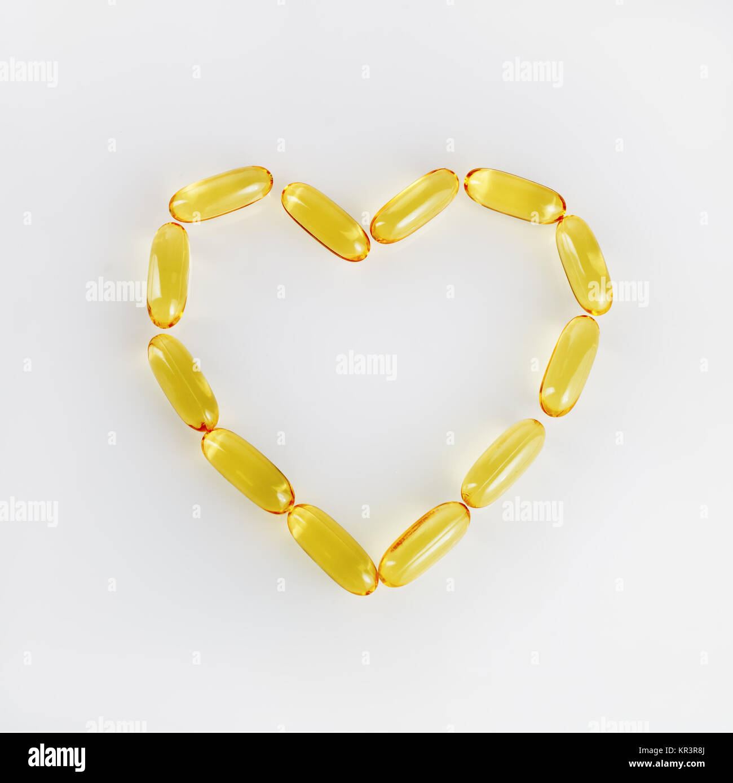 Pills in heart shape - Stock Image