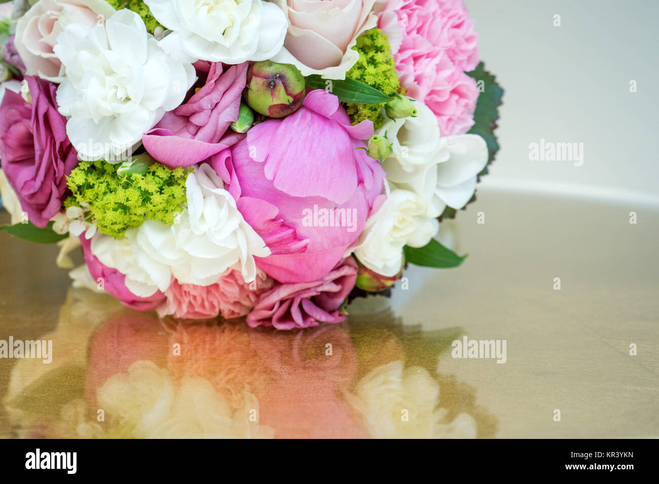 Bridal Bouquet With Pink And White Flowers On A Gold Tabletop Stock