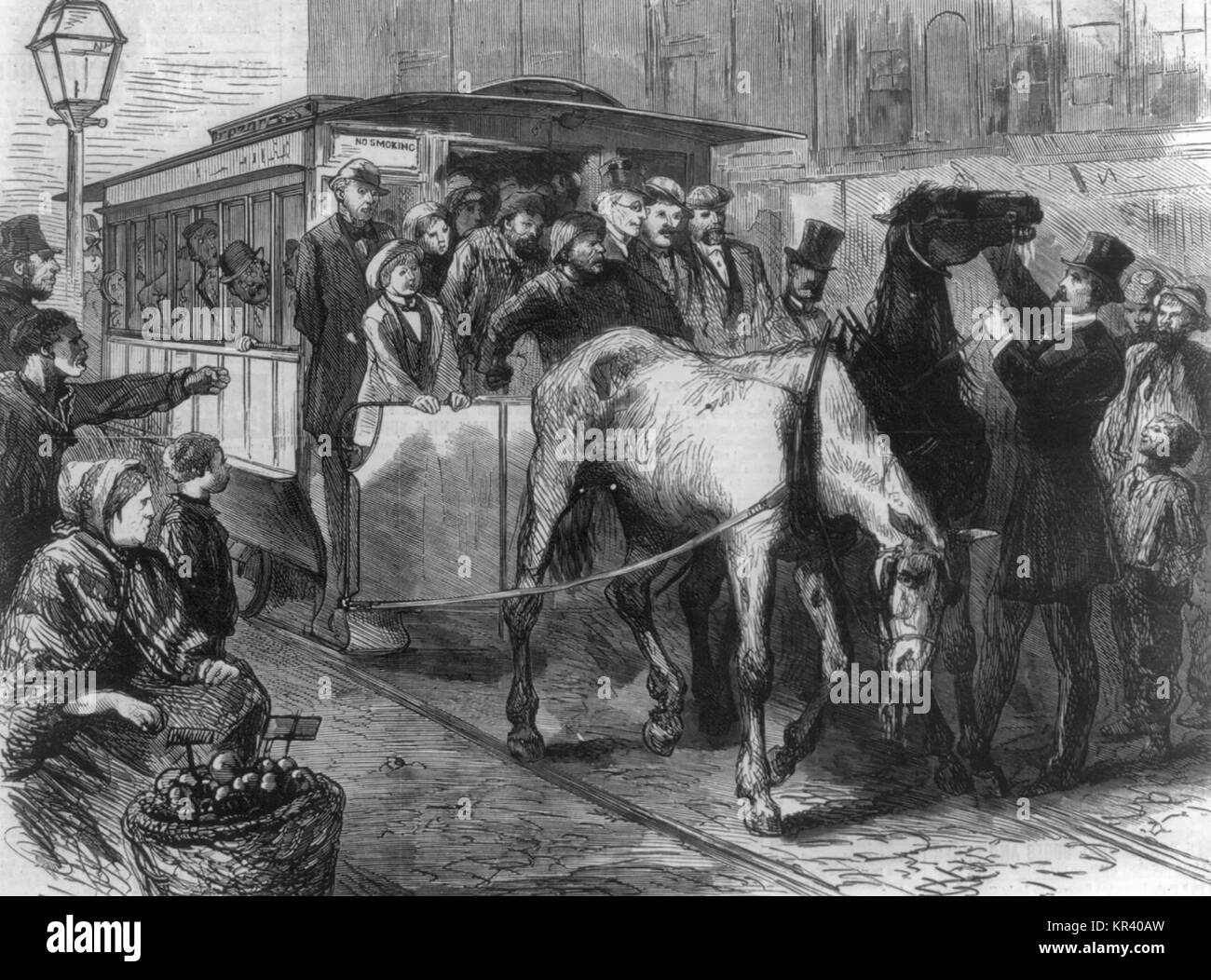 The Crowded car - Pair of horses unable to pull overcrowded street car in New York City, 1872 - Stock Image