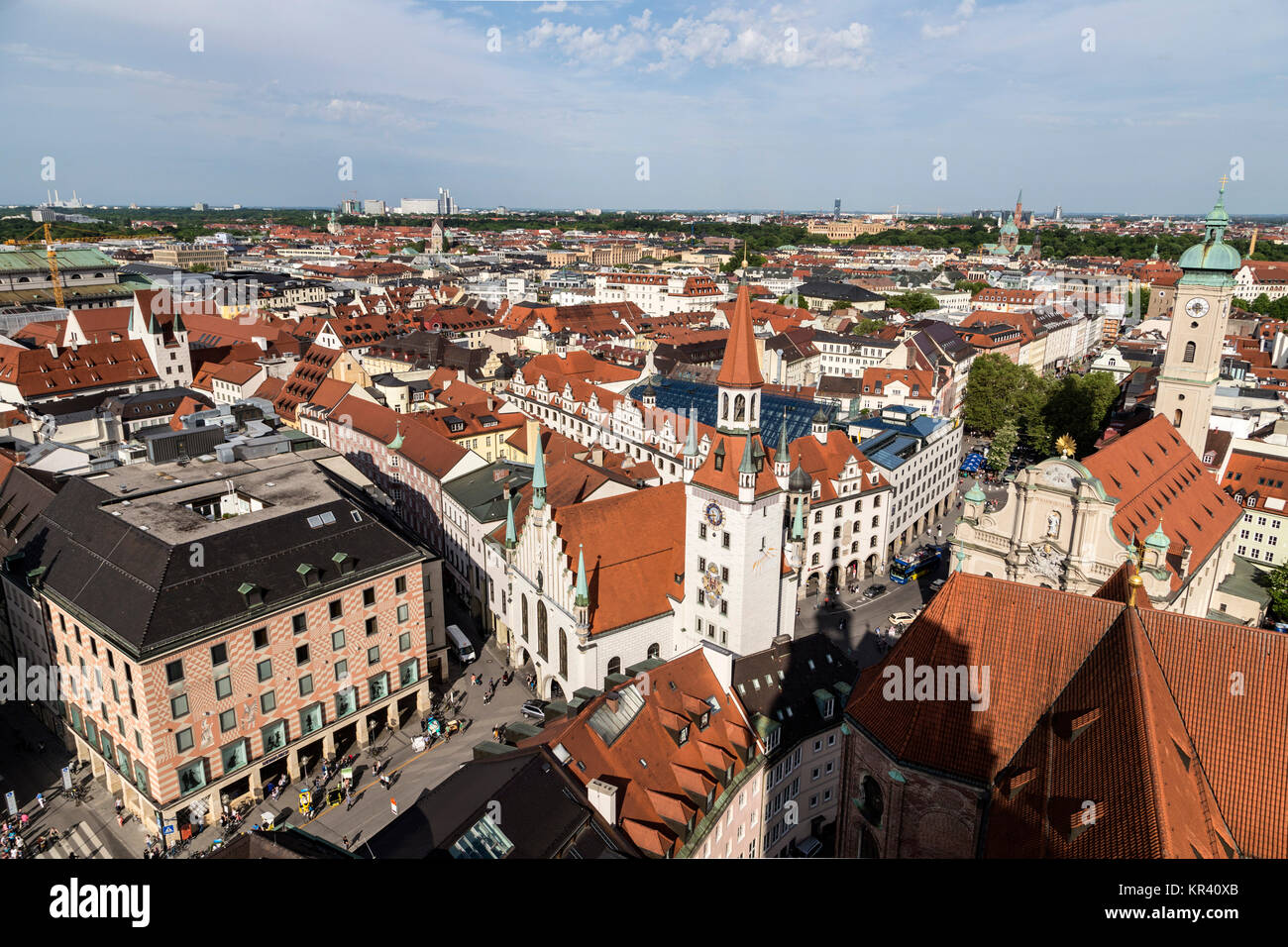 Beautiful super wide-angle sunny aerial view of Munich, Bayern, Bavaria, Germany with skyline and scenery beyond the city, seen from the observation deck of St. Peter Church Stock Photo