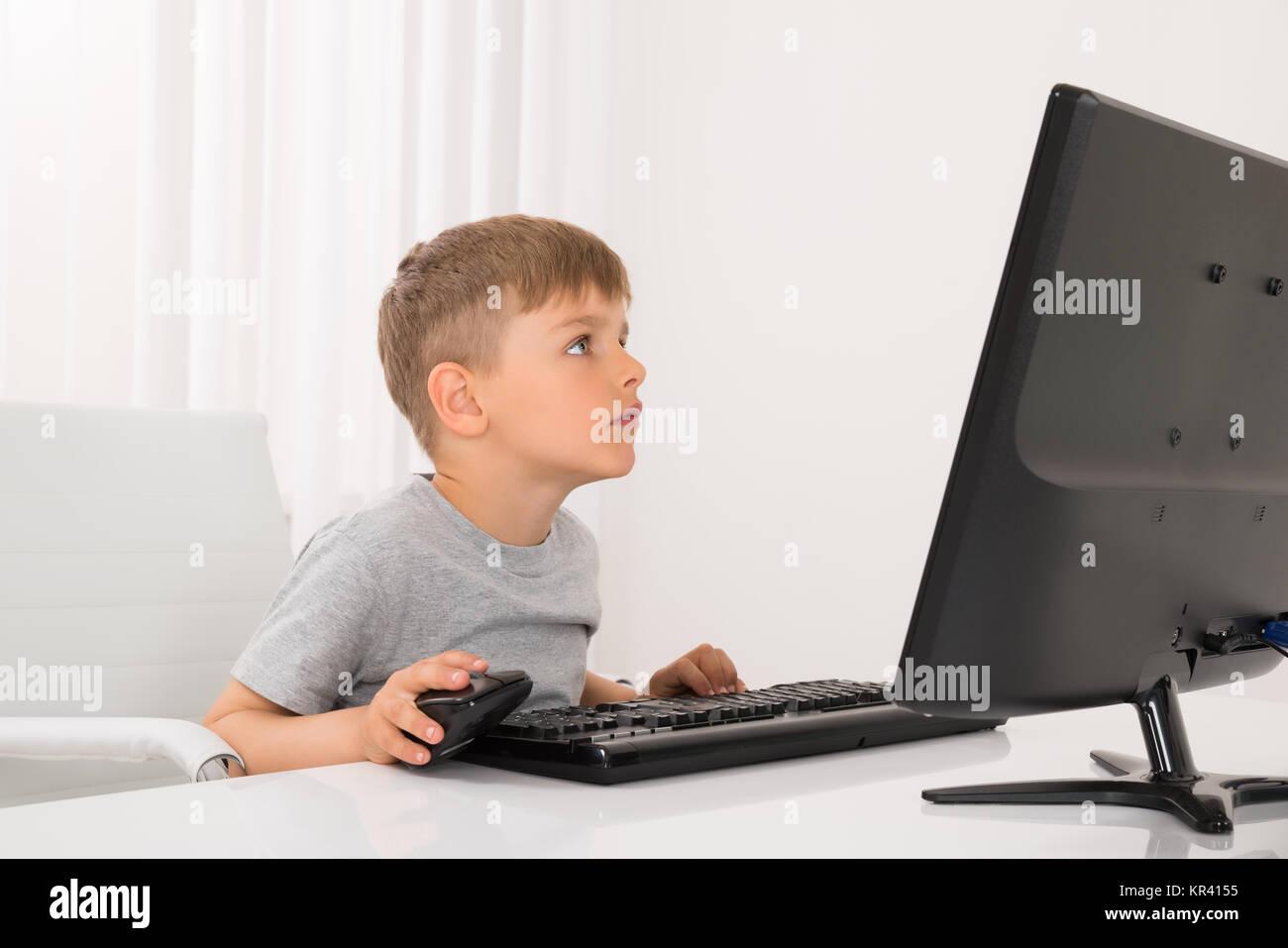 Boy Using Computer - Stock Image