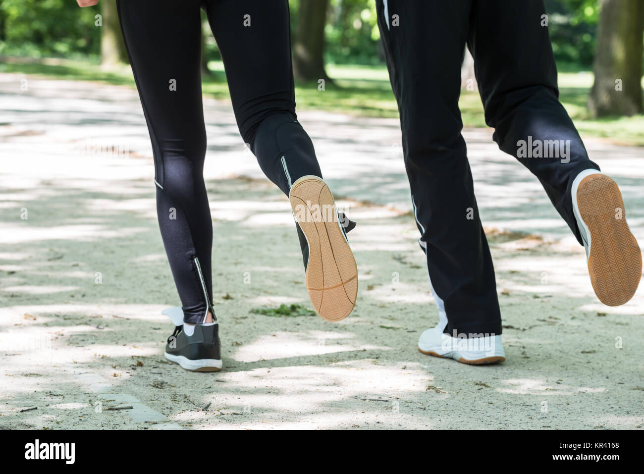 Couple Jogging In Park - Stock Image
