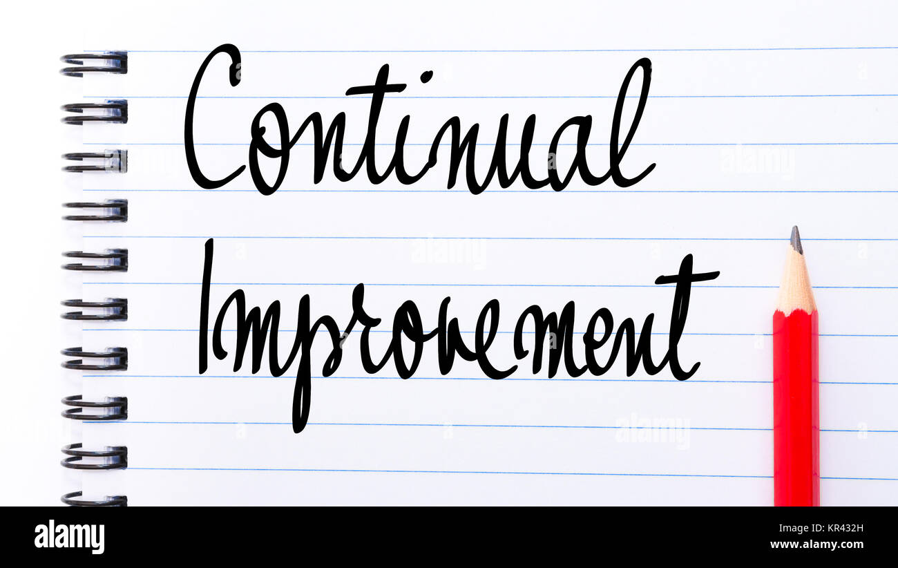 Continual Improvement written on notebook page - Stock Image