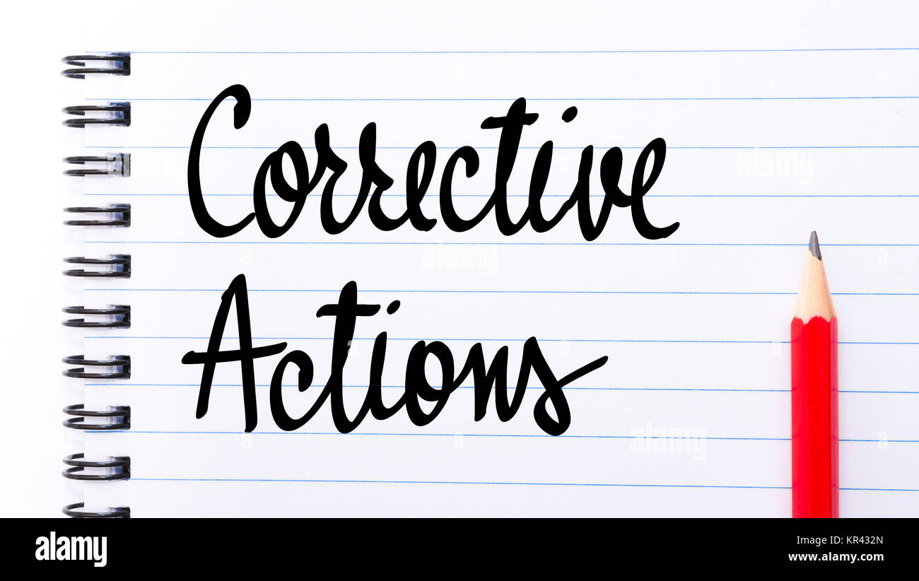 Corrective Actions written on notebook page - Stock Image